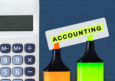 taxpayers: Accounting and financial service concept. Calculator and highlighters.