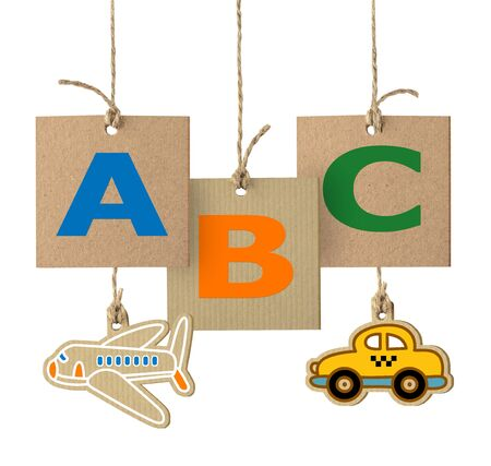 school of fish: ABC letters and toys on cardboard label with rope, alphabet logo design isolated on white.
