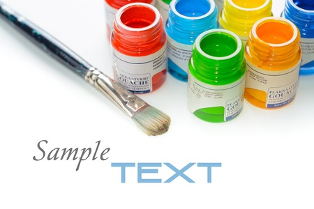 Glass Jars with colour paints on white background