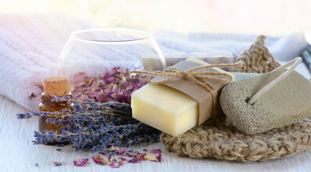 Handmade Soap with bath accessories on marble background