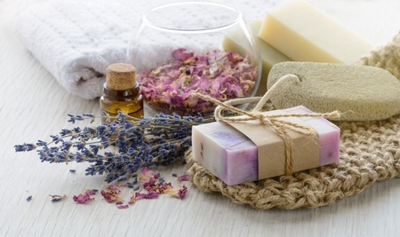 Handmade Soap with bath and spa accessories on marble background