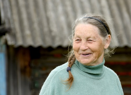 Portrait of smiling elderly woman outdoors