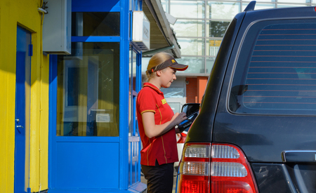 Moscow, Russia - August 2, 2017: Mcdonald's worker taking an order from customer in McDonald's drive thru service, McDonald's is an American fast food restaurant chain Éditoriale
