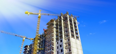 heavy industry: Crane at the construction of residental building. Stock Photo