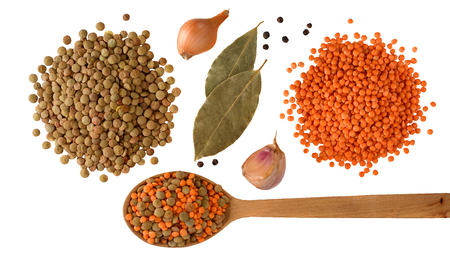 Red and green Lentils with onion, garlic and spices with wooden spoon isolated on white background. Healthy lifestyle. Lentil soup ingredients . Flat lay. Top view. Stock Photo