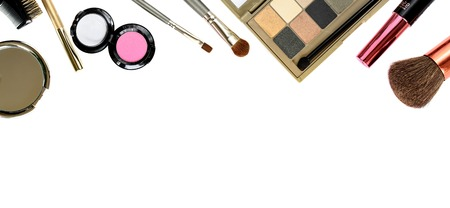 Cosmetics set with brushes and eyeshadows isolated on white for border or background Banco de Imagens