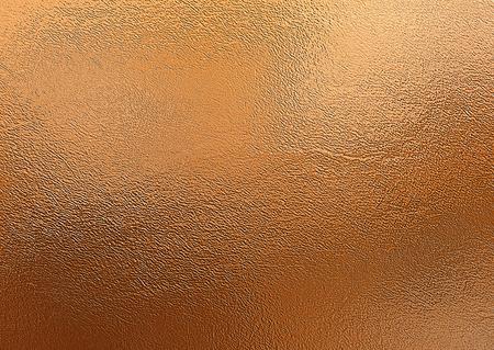 Brązowe tło. Dekoracyjna tekstura folii metalowej
