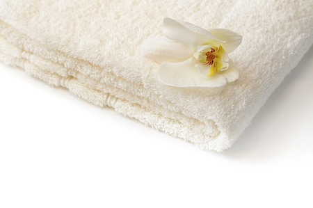 Bath Spa towel with white Orchid flower on white