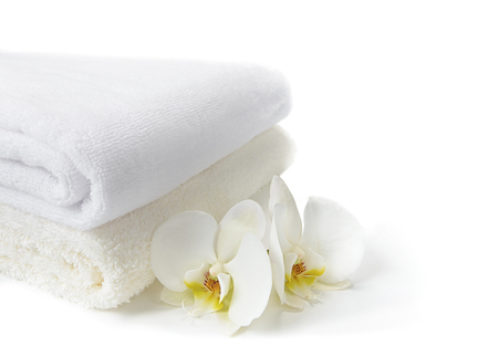 Spa towels with white Orchid flowers on white
