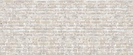 Reticolo senza giunte del muro di mattoni beige. Archivio Fotografico