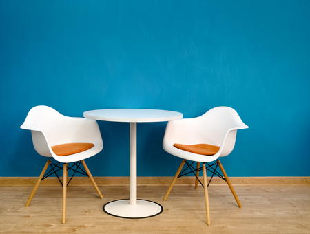 Modern interior table and two chairs.
