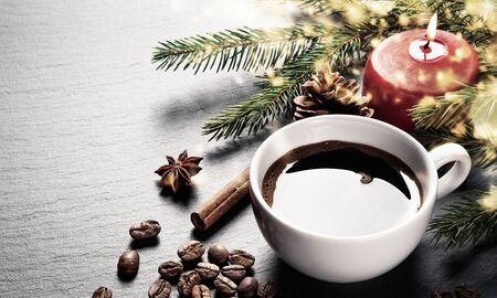 Coffee cup and coffee beans with christmas decoration