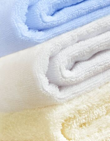 Stacked colorful pastel bath towels Imagens - 128592179