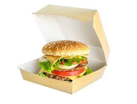 Big Hamburger in cardboard box isolated on white. Banco de Imagens