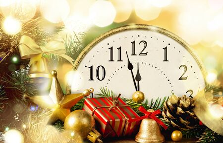 Retro style clock with christmas and new year decorations.