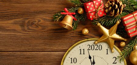 Happy new year 2020. Retro style clock with christmas decorations.