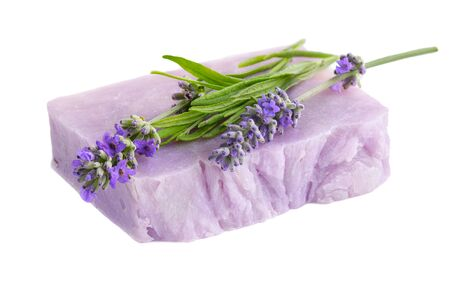 Homemade lilac lavender soap with lavender flowers atop.