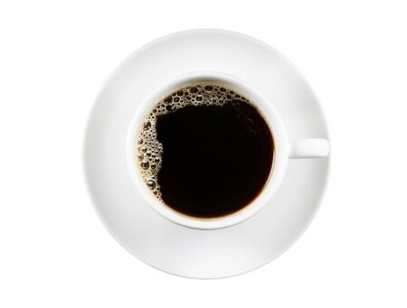 Black Coffee in white ceramic cup isolated on a white Background. Top view