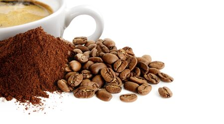 Pile of coffee powder, coffee beans and cup of espresso isolated on white Фото со стока