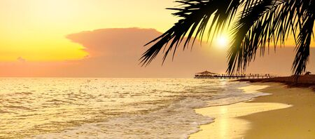 Golden Sunset on the beach in tropical resort