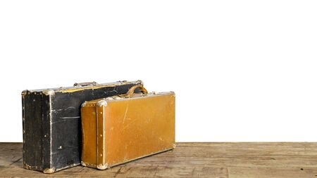 Old suitcases on wooden floor isolated on white