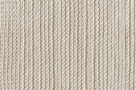 Beige knitting woolen fabric texture background