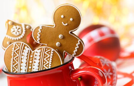 Gingerbread cookie men in a red cup