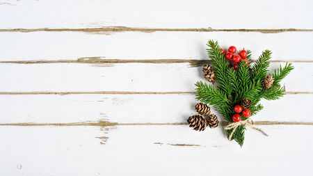 Christmas tree branch on white wooden planks