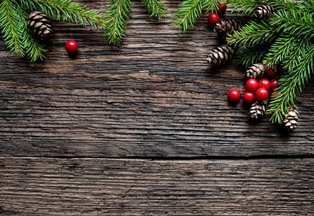 Christmas fir tree branch on old wooden background