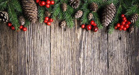 Christmas tree branches on rustic wooden planks background