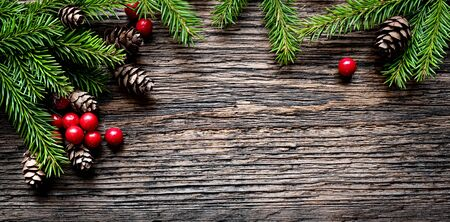 Christmas tree branches on rustic wooden background