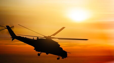Helicopter silhouette flying in the sky at sunset 版權商用圖片