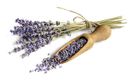 Bunch of dried lavender and wooden scoop with flower buds on white background. Imagens