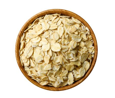 Oat flakes in wooden bowl isolated on white. 版權商用圖片