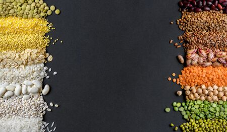 Dry Cereals and legumes on black background.