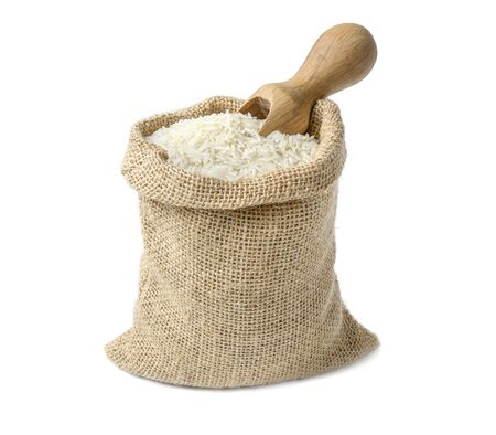 White long rice in burlap sack isolated on white.