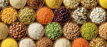 Various colorful cereals and legumes background