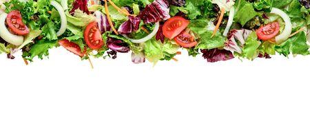 Fresh salad leaves mix border or background isolated on white