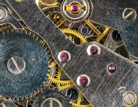 Clockwork background of old clock pocket Watch mechanism with Gears.