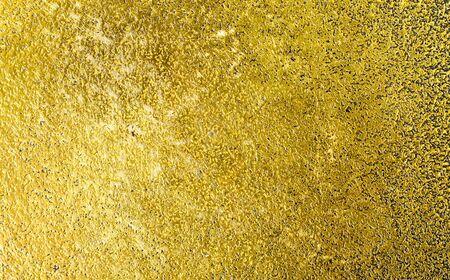 Texture oro con graffi. Superficie del fondo del piatto d'ottone dorato