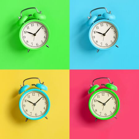 Multicolored alarm clocks collage on bright colorful backgrounds. Top view. Flat lay