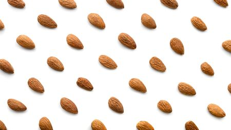 Almond nuts pattern isolated on white background. Top view of roasted almond.