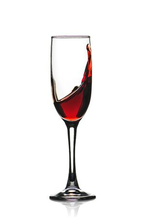 Red wine Splashing in a glass isolated on white.
