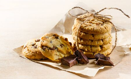 Chocolate chip cookies stack on wooden table background