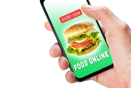 Hand holding phone with app ordering and delivery food on screen isolated on white.