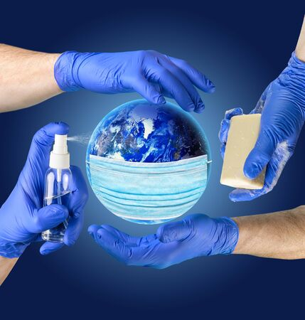 Earth planet in medical protective mask. Hand sanitizer spray, antibacterial soap, hands in latex gloves - main protective measures against coronavirus COVID-19. Dark blue background.