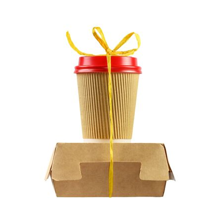 Fast food paper containers tied with yellow rope isolated on white.