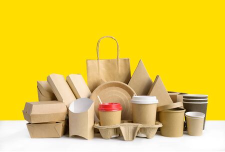 Fast food packaging set on yellow background.