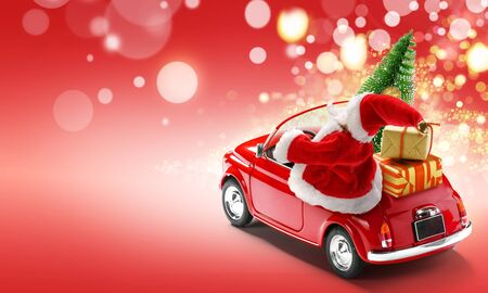 Santa Claus in red car delivering gift boxes and Christmas tree on red background with bokeh lights Imagens