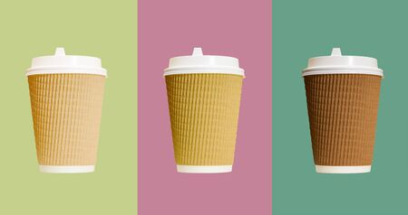 Three paper coffee cups with white lid isolated on colorful backgrounds. Imagens